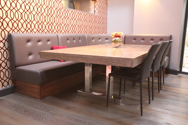 Large Extending Dining Table With Polished Legs And Banquette